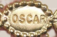 Oscar de la Renta Metal Hang Tag